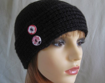 Black cloche hat with striking buttons