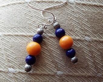 purple and orange bead earrings