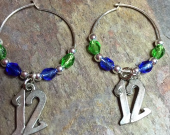 "Silver hoops with""12""s green and blue"
