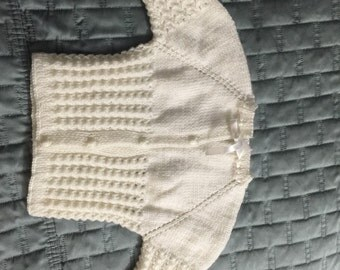 Hand knitted sweater for babies