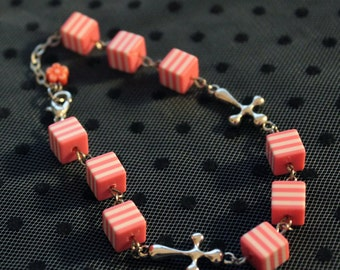 Bracelet with Silver Cross and beads pink and white cubes