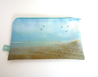Pouch realized from a embroidered ocean photo