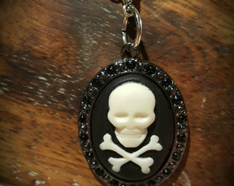 Black and Creamy White Skull and Crossbone Cameo necklace on a silver chain