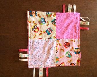 Baby's sensory taggie blanket, pink theme.