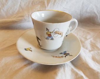 Circus/clowns tea cup and saucer