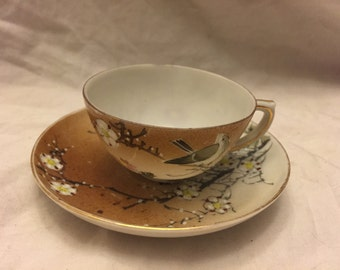 Demitasse Cup and saucer brown white with Bird in flowering tree