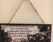 Inspired by Fallout  It is in our nature to want to forget truths that keep us awake at night  wall plaque
