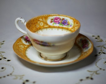 Vintage floral yellow teacup and saucer set