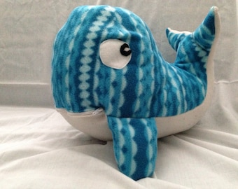 Whale stuffy with zippered mouth.