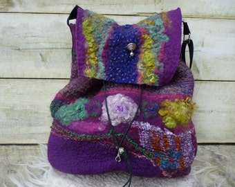 felted bag with sturdy nylon adjustable strap. felted bag with sturdy nylon adjustable strap.