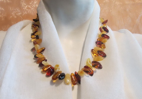 "100% Natural Baltic Amber Necklace, weight 23.6 grams, length 20.08"" (51 cm), 3 colors - cognac, yellow and brown, transparent. C019"