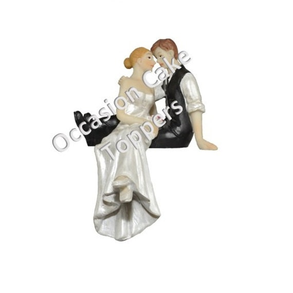 wedding cake topper bride and groom sitting on cake polyresin