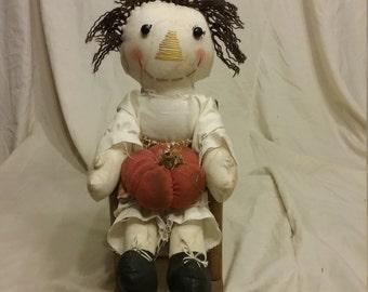 Peggy the pumpkin doll