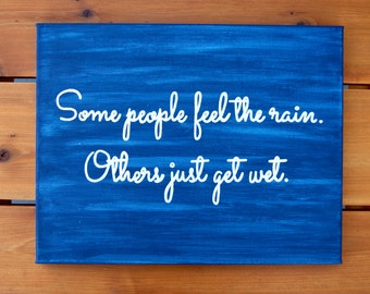 Blue Multi-Color Quote Canvas Painting - Some People Feel The Rain. Others Just Get Wet.