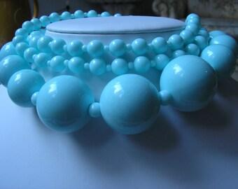 BLUE PLASTIC NECKLACE