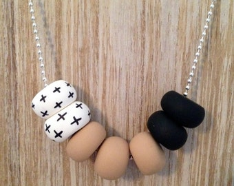 """Polymer Clay Necklace - """"Crosses, tan & black"""""""