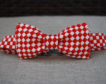 Reddish-orange checkered bow tie
