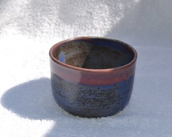 Lavender and red ceramic bowl