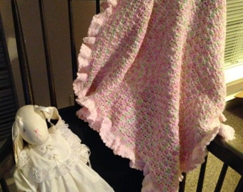 Crocheted Pink w/green highlights baby blanket
