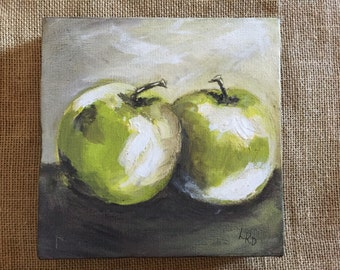 Quite a pair of beautifully painted green apples.