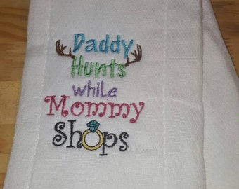 Daddy hunts while mommy shops embroidered burp cloth