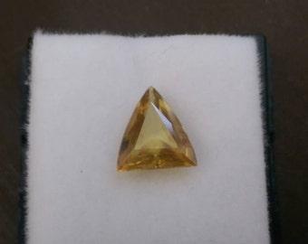 1ct faceted sphene gemstone.