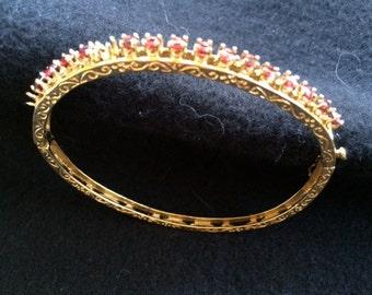SALE!!! New Lower Price!  Ladies 14-Karat gold bangle with 17 round cut garnets [circa 1940s]