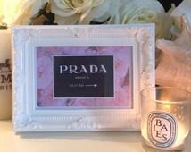 Prada Marfa designer print in vintage style frame.
