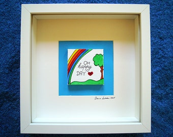 """Rainbow abstract on canvas in a frame 25 x 25 x 5 cm (9,84"""" x 9,84"""" x 1,99"""") turquoise background in a white frame """"Oh happe day"""""""