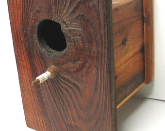 Small natural wood birdhouse