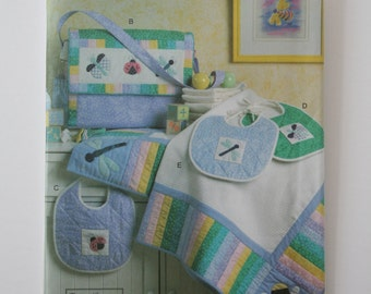 Vogue Craft 7868 - Infants Quilt, Diaper Bag and Bibs.