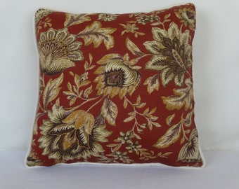 Burgundy decorative pillow with flowers