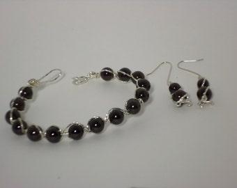 "Sterling Silver WireWrapped Bracelet with ""Ruby"" Garnet Beads"