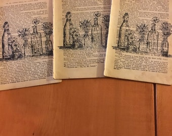 Hand stamped vintage book pages