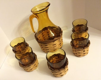 Unique Amber Glass Pitcher and 5 glasses with woven holders