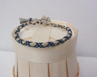 Brazilian man or woman off-white blue wristband black