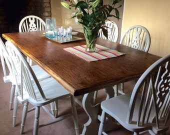 Large solid oak table and Six wheel back chairs