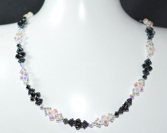 """Necklace """"Heads or Tails"""" crystal Swarovski crystal and hematite 2x ab2x"""