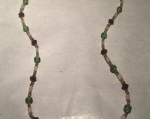 White, green purple and gold beaded necklace