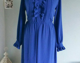 Royal blue 1980s dress with a high neck ruffled neck.