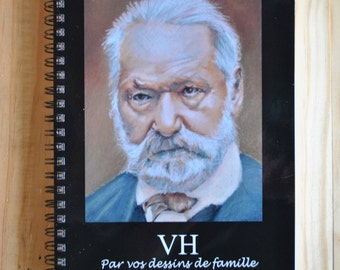"A spiral notebook, illustrated by a pastel by ""your drawings of family"""