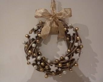 Wooden christmas wreath for door or indoor decoration hand decorated in white and gold