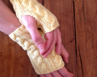 Knitted yellow Japanese mittens hand