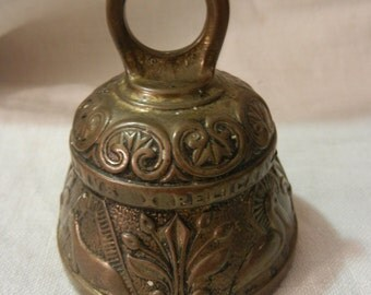 Ornate brass without flying the Bell