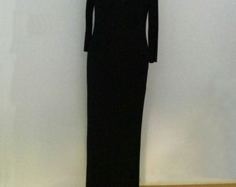 Black rayon full length dress with side split and three quarter length sleeves.