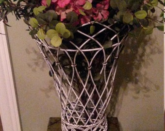 Shabby chic metal basket vase with silk flowers and greenery