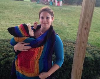 Dark rainbow colored baby wearing blanket