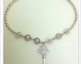 Key and pearl necklace