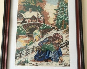 "Framed finished Cross Stitch: ""Girl picking up wood"""