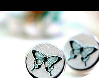 Blue and white wooden butterfly earrings